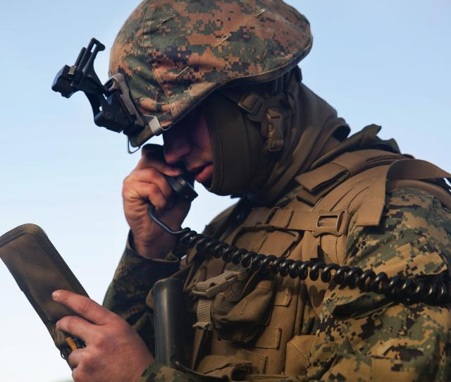 Marine Corps Cpl Clayton L Campbell Communicates With The Combat Operations Center During Exercise