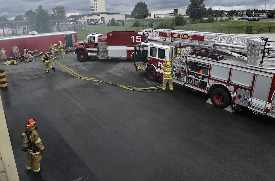 Airmen from the 86th Civil Engineer Squadron participate in a biannual-training exercise June 2, 2016, at Ramstein Air Base, Germany. The 86th CES Airmen provide fire emergency services to Ramstein Air Base, Vogelweh Military Complex, Rhine Ordinance Barracks and Landstuhl military sites. (U.S. Air Force photo/Senior Airman Larissa Greatwood)