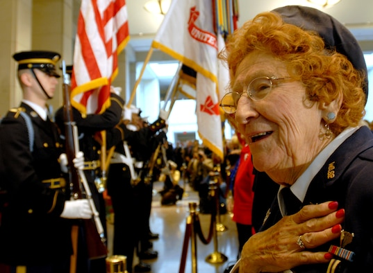Betty Wall Strohfus, right, a former pilot with the Women Airforce Service Pilots (WASP), sings the national anthem during the Congressional Gold Medal ceremony at the U.S. Capitol in Washington, D.C., March 10, 2010. The Congressional Gold Medal is the highest civilian award bestowed by Congress. The WASP program, established during World War II, trained women to fly noncombat military missions. (U.S. Air Force photo/Staff Sgt. J.G. Buzanowski)