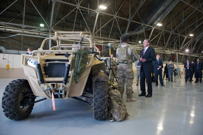 Defense Secretary Ash Carter speaks with troops assigned to the 62nd Airlift Wing on Joint base Lewis-McChord, Wash., March 4, 2016. Carter said their posture and power projection capabilities play a pivotal role in DoD's rebalance to the Asia-Pacific. DoD photo by Navy Petty Officer 1st Class Tim D. Godbee