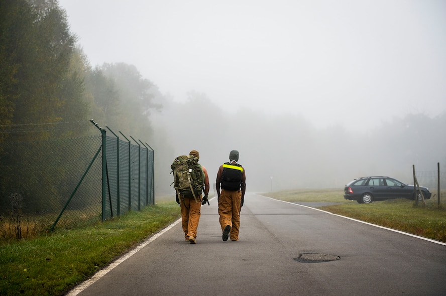 786th Civil Engineer Squadron supervisor Staff Sgt. Israel Ortiz, left, participates in a ruck and run event with Staff Sgt. Berron Johnson, 786th CES NCO in charge of structures at Ramstein Air Base, Germany, Oct. 28, 2016. The 786th CES's explosive ordnance disposal flight conducts monthly ruck marches which are open to participation from any unit on Ramstein. (U.S. Air Force photo by Airman 1st Class Joshua Magbanua)