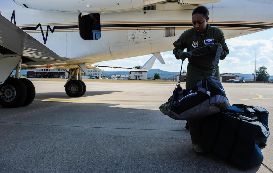 Senior Airman Brionna Coleman, 86th Aeromedical Evacuation Squadron mission launch aeromedical evacuation technician, transports bags between a Gulfstream III and an ambulance during an aeromedical evacuation mission Sept. 1, 2016, at Ramstein Air Base, Germany. Providing essential care in multiple medical roles, Aerospace Medical Service specialists assist doctors and care for patients in a wide range of situations. (U.S. Air Force photo/Airman 1st Class Lane T. Plummer)