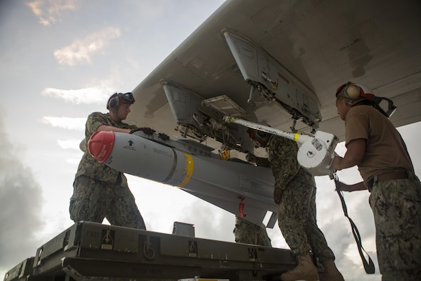 U.S. Navy sailors with Patrol Squadron 46 load a P-3 Orion aircraft with AGM-65F MAVERICKS Air to Surface Missiles prior to a sinking exercise (SINKEX) Sept. 13, 2016, at Andersen Air Force Base, Guam, during Valiant Shield 2016. SINKEX provided service members the opportunity to gain proficiency in tactics, targeting, and live firing against a surface target at sea. Valiant Shield is a biennial, U.S. -only field-training exercise with a focus on integration of joint training among U.S. forces. (U.S. Marine Corps photo by Sgt. Justin Fisher)