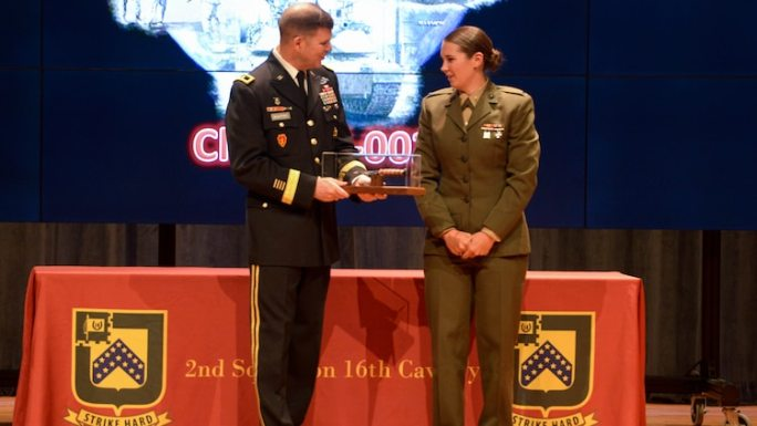. Second lieutenant Polatchek presents an instructor with a graduation gift during the Army's Armor Basic Officer Leaders Course at Fort Benning, Georgia, April 12, 2017. Polatchek graduated at the top of her class and is now the first female Tank Officer in the Marine Corps.