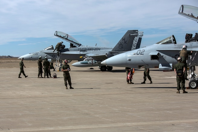 Marines perform preflight checks on F/A-18D Hornets during exercise Jaded Thunder 17 at Salina, Kansas, Feb. 22, 2017. The Marines are assigned to Marine All-Weather Fighter Attack Squadron 224, participated in the joint service exercise, to complete training requirements and prepare for future deployments. Marine Corps photo by Lance Cpl. Zachary M. Ford