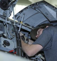 aaron miller 309th aircraft maintenance and regeneration group aircraft technician installs a wiring harness [ 3988 x 2654 Pixel ]