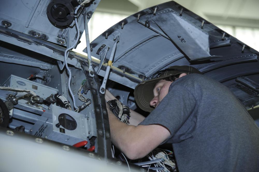 medium resolution of aaron miller 309th aircraft maintenance and regeneration group aircraft technician installs a wiring harness