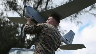 Lance Cpl. Nicholas Powell, a Marine with 1st Battalion, 12th Marine Regiment, prepares to throw the Unmanned Aerial System at Marine Corps Training Area Bellows, Hawaii, March 8, 2017. The UAS is mainly used for aerial reconnaissance and can also be used for observation, local security, targeting, and prosecuting.