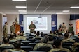 U.S. Marine Corps Col. Brian Ecarius, the senior representative from U.S. Marine Corps Forces, South, addresses a group of U.S. and partner nation Marines and Sailors during a question and answer portion of a multinational amphibious planning conference to highlight the significance of integration and interoperability with partner nations in Ancon, Peru, July 16, 2021. Amphibious partners from Peru, Argentina, Brazil, Chile, Colombia, Ecuador, Mexico, Uruguay, and the United States gathered at the newly established International Amphibious Training Center to share experiences, tactics, and lessons learned related to amphibious operations.