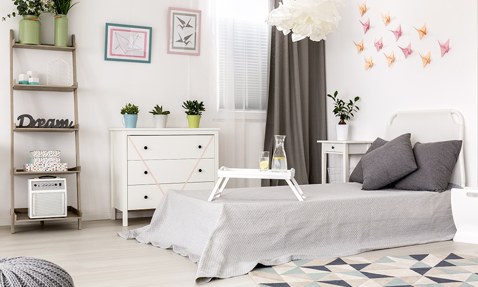 A white wall filled with cranes, planes, birds, made from origami paper is excellent bedroom wall decor ideas DIY.