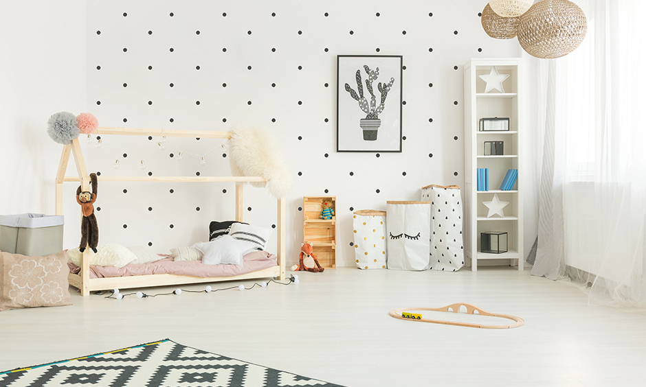 DIY bedroom ideas decorate a white wall with polka dot to make it more attractive.