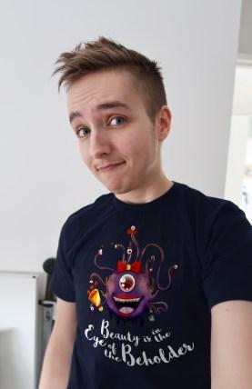 TJ Wearing the Beautiful Beholder Shirt