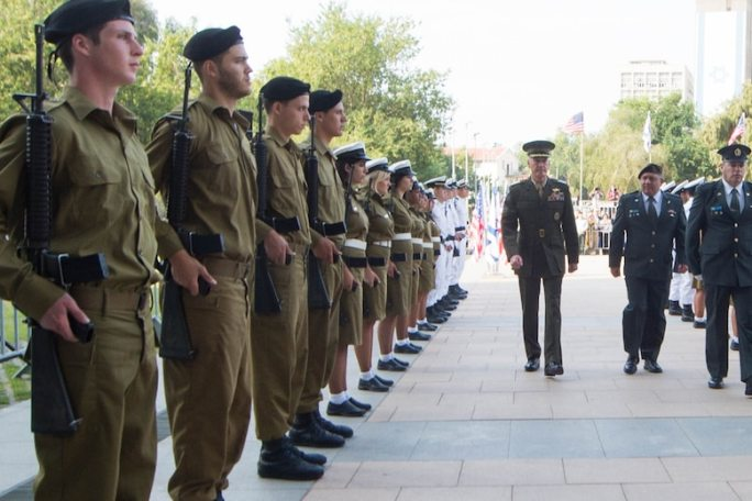 U.S. Marine Corps Gen. Joseph F. Dunford Jr., chairman of the Joint Chiefs of Staff, walks with Israeli officials past the Israeli Defense Forces honor guard during an official welcome ceremony at the IDF headquarters in Tel Aviv, Israel, Oct. 18, 2015. DoD photo by D. Myles Cullen