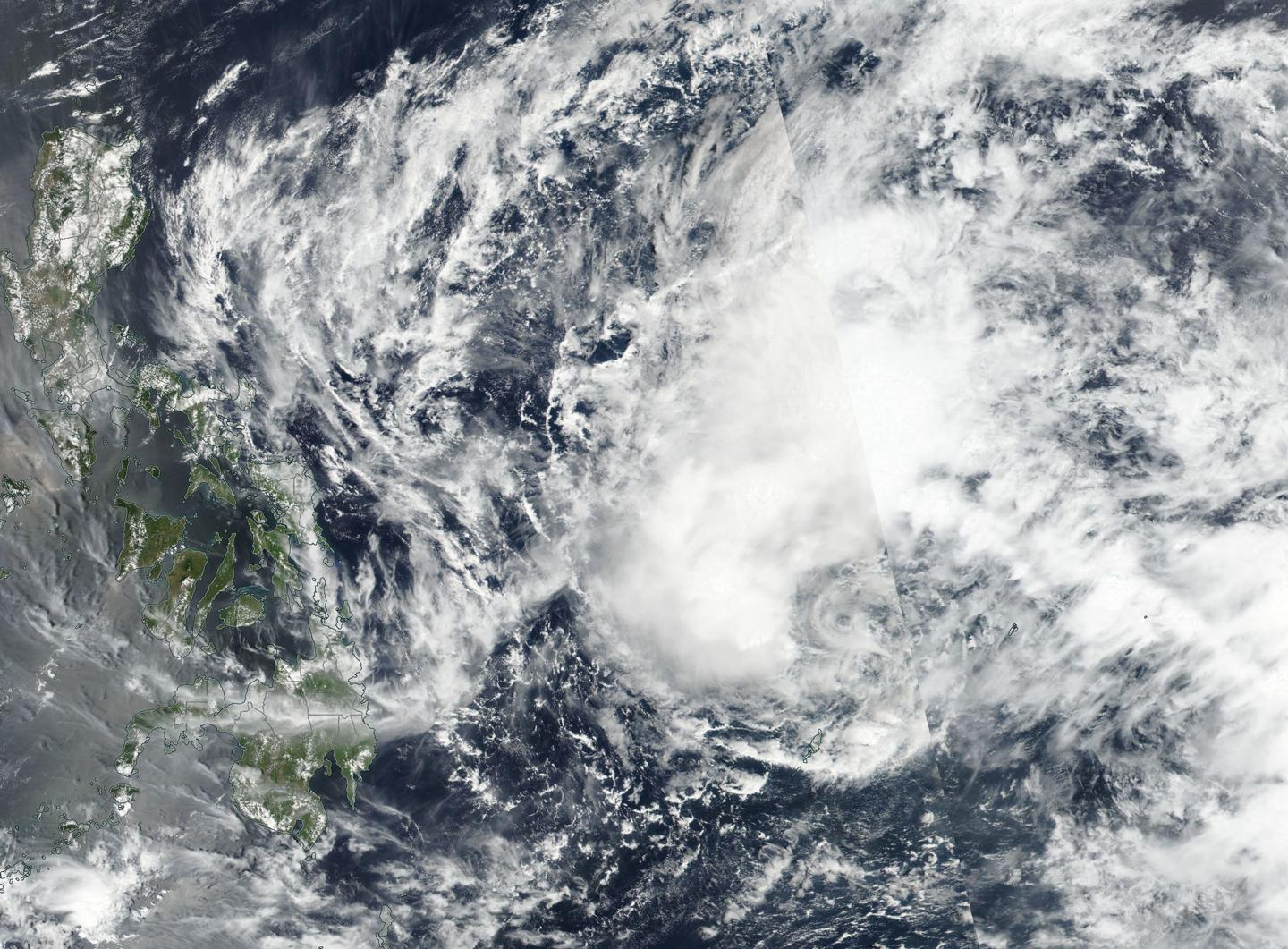 Satellite finds southerly wind shear affecting Tropical Depression ...