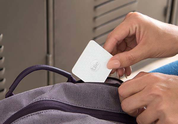 the tile slim bluetooth tracker fits in your wallet gadgetsin