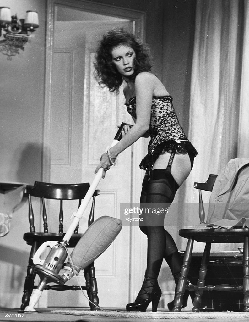 Actress Elisabeth Wiener using a vacuum cleaner while