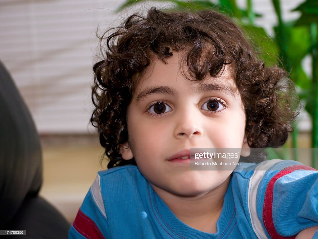 curly brown hair boy stock