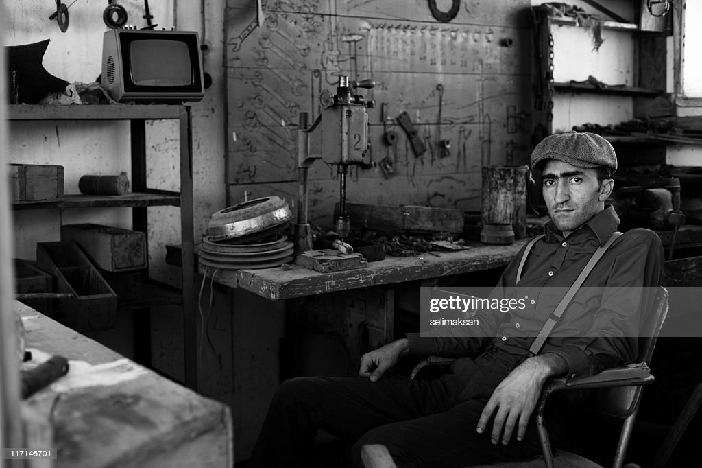 Adult Man Working In Old Fashined Garage Stock Photo