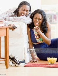 African Couple Watching Television In Living Room Stock ...