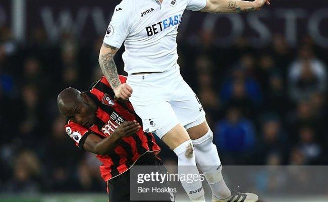 Alfie Mawson Of Swansea City And Benik Afobe Of Afc