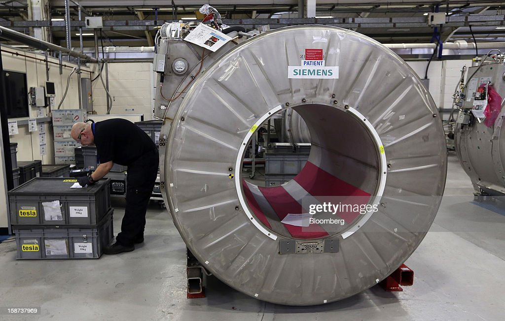 An employee checks a goods stock list near a magnet, manufactured for... News Photo - Getty Images