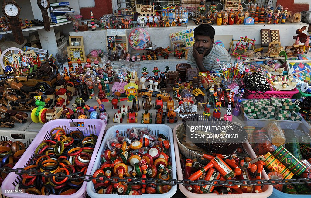 An Indian Shop Keeper Waits For Customers At Channapatna