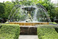 Angel Sculpture Fountain In The Garden Stock Photo | Getty ...