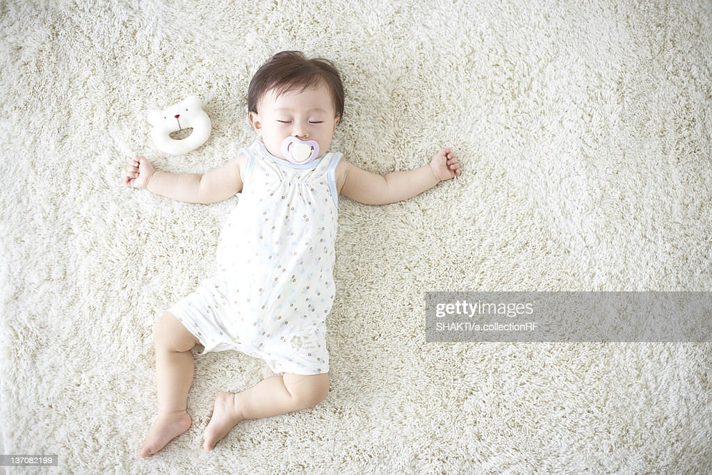Baby Lying Down On Carpet Sleeping Getty Images