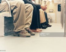 Barefoot Man Sitting Bench In Subway Car Angle View