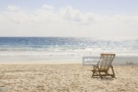 Beach Chair On Beach Next To Ocean Stock Photo