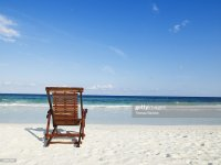 Beach Chair On Empty Tropical Beach Stock Photo | Getty Images