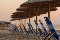 Beach Chairs And Umbrellas In A Row At Sunrise Stock Photo ...