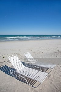 Beach Chairs On Atlantic Ocean Beach Stock Photo