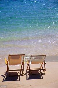Beach Chairs On The Shoreline Of A Tropical Beach Calm ...