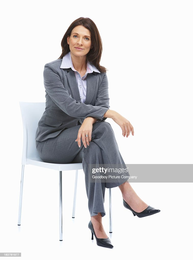 Beautiful Businesswoman Sitting On A Chair Stock Photo