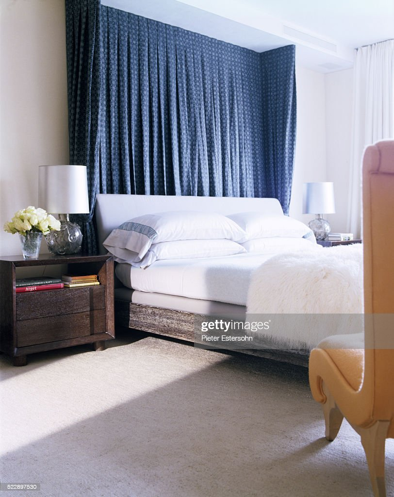 bed with curtains hanging behind headboard high res stock photo getty images