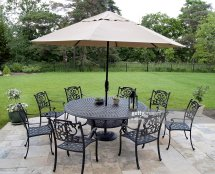 Black Metal Patio Furniture Set With Tan Umbrella Stock