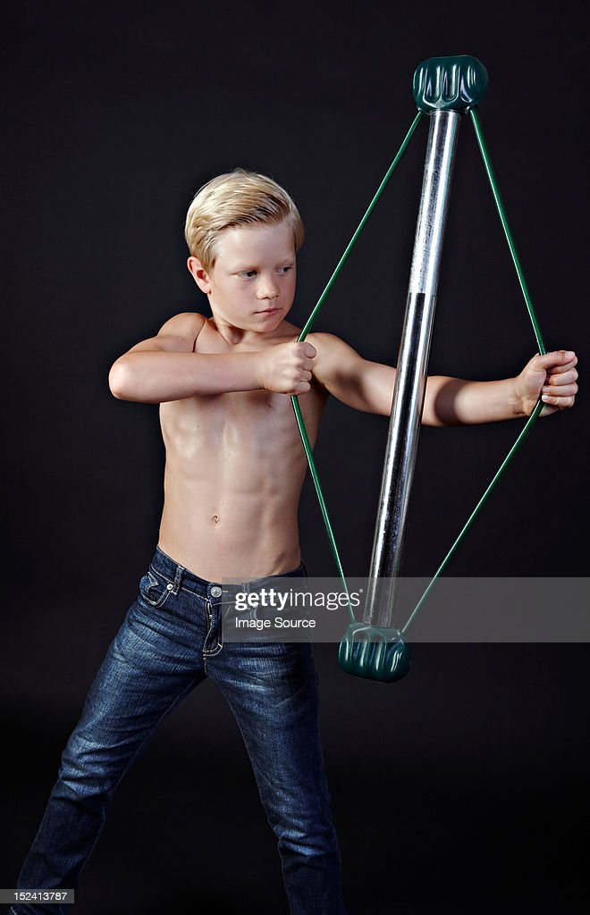 Boy Using Chest Expander Stock Photo Getty Images