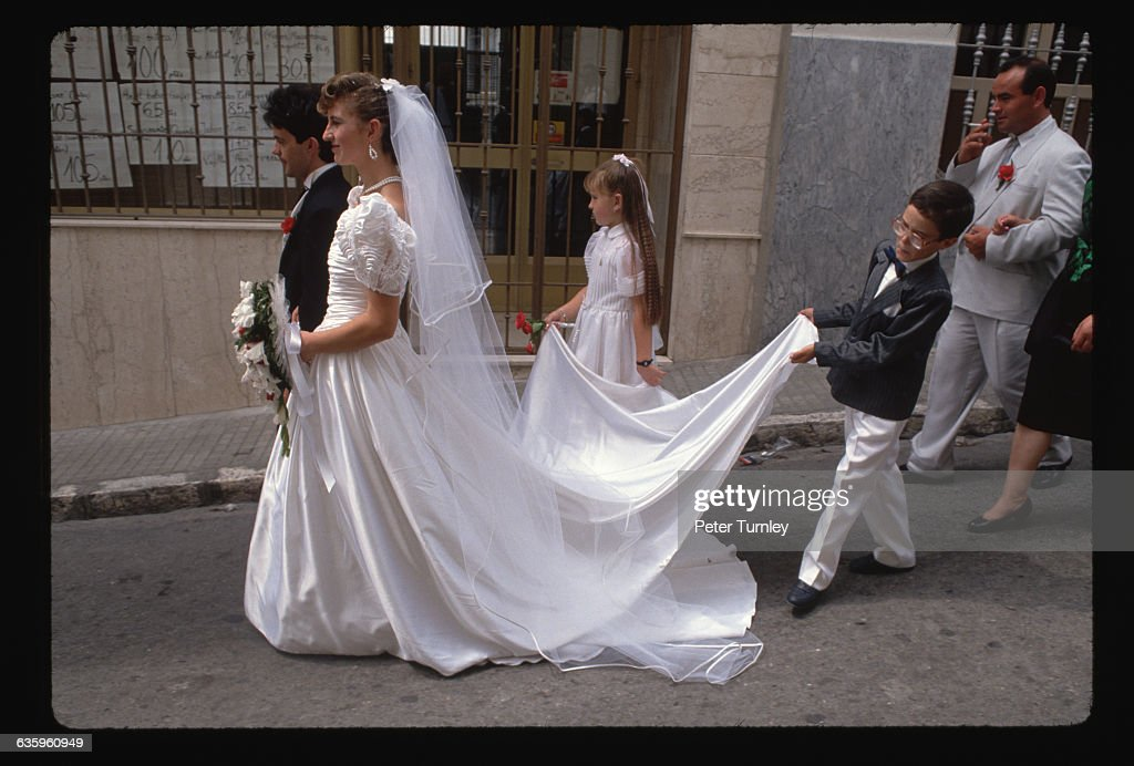 Bride And Bridegroom Walking Down Street With Children