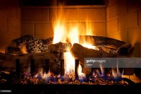 Burning Logs And Glowing Embers In Gas Fireplace Stock ...