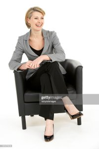 Business Woman Sitting In Chair Stock Photo | Getty Images