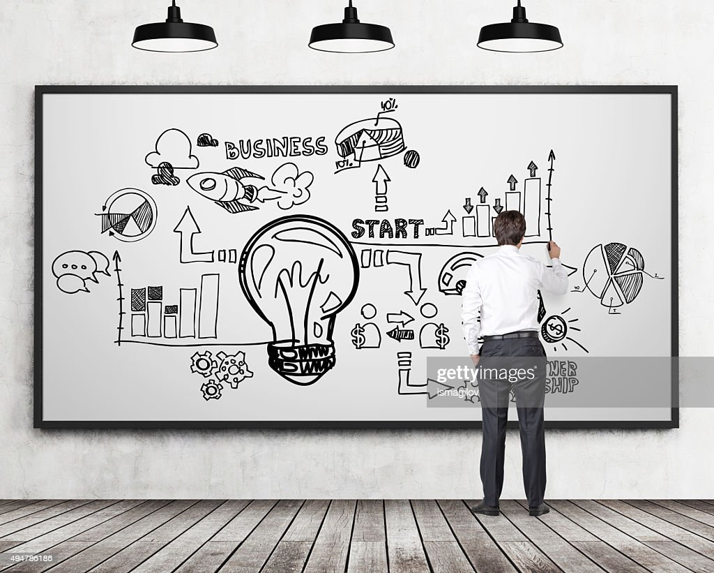 Businessman drawing  business flowchart on the whiteboard also stock rh thinkstockphotos