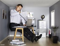 Businessman Working In Small Office Stock Photo | Getty Images