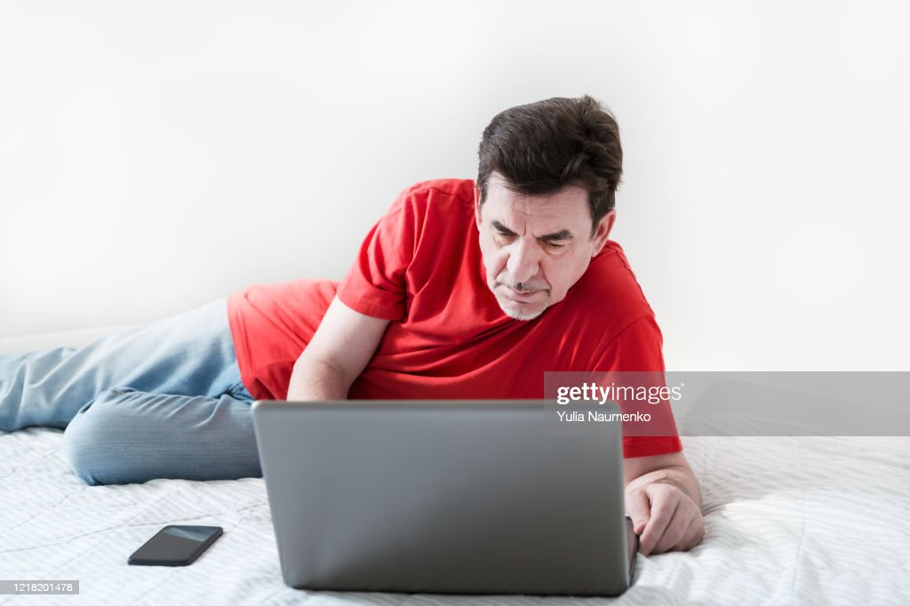 https www gettyimages com detail photo calm bearded man with laptop in bed with white royalty free image 1218201478