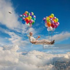 Chair With Balloons Patio Dining Cushion Covers Caucasian Man On Lawn Floating In Sky Stock Photo