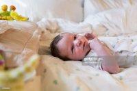 Caucasian Newborn Baby Boy Laying On Bed Stock Photo ...