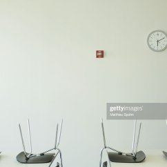 Chair Upside Down On Wall Golden Technology Lift Chairs Tables And Clock Stock Photo Getty