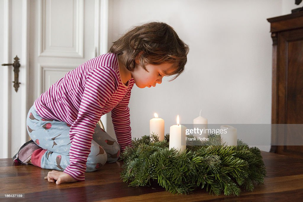Close Up On Christmas Tree And Stocking Hanging On Fireplace Stock Christmas Candle Stock Photos And Pictures | Getty Images