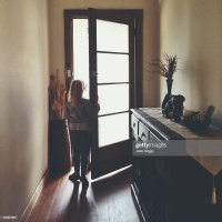 Child Opening Front Door Rear View Stock Photos and