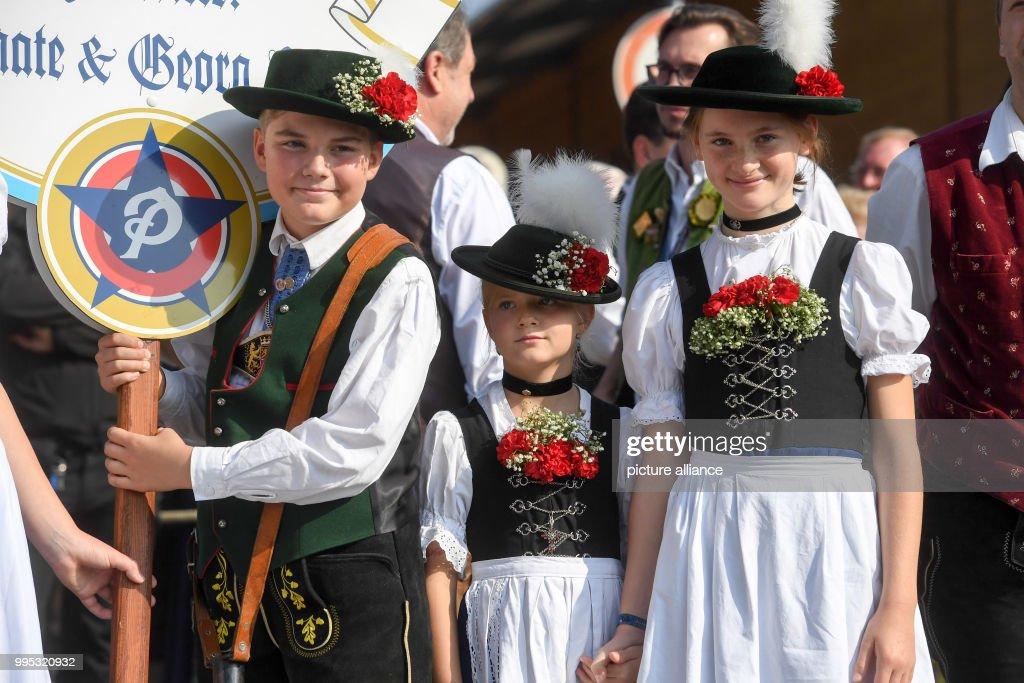 children wearing traditional dress